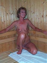 Mature slut getting hot in the sauna