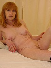 Red mature slut showing off her body