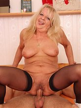 The sexy mature blonde pulls those legs apart so he can pump his thick young meat into them