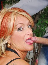 Hot mature Joanna Depp welcomes a younger guy into her dressing room and fucks him live
