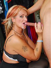 Busty older babe Joanna Depp joins a younger guy in the dressing room for hot sex live